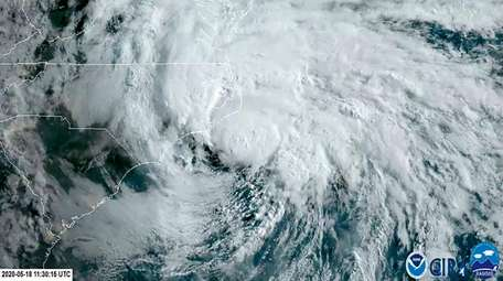 A satellite image shows Tropical Storm Arthur off