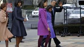 President Barack Obama, accompanied by his daughters Sasha