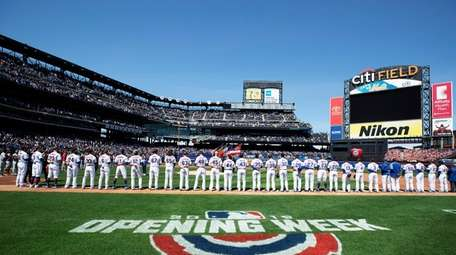The Mets stand for the National Anthem against