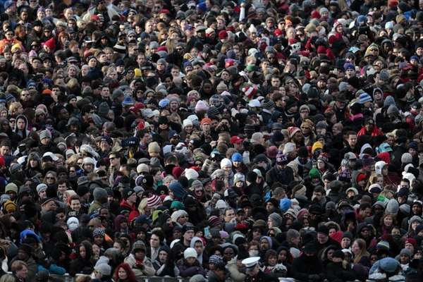The crowd watches outside the Capitol during the