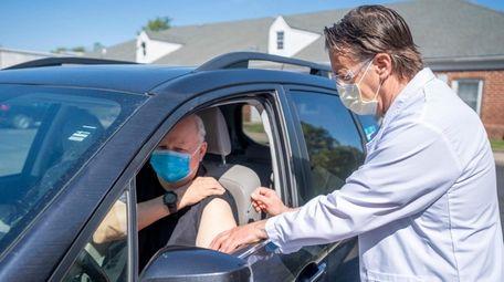 Riverhead allergist Dr. John F. Byrne gives an