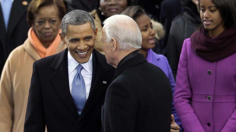 President Barack Obama greets Vice President Joe Biden