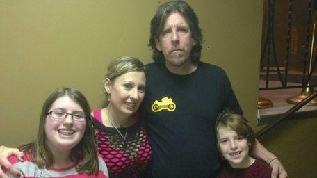 From left, Amber Cresser, 12, parents Dawn Cresser