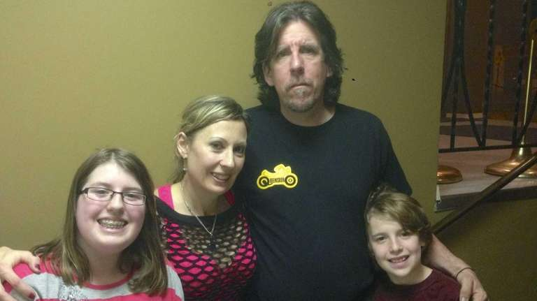From left, Amber Cresser, 12, parents Dawn Cresser