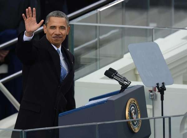 President Barack Obama waves after taking the oath
