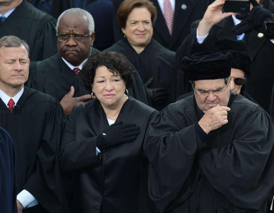 U.S. Supreme Court Chief Justice John Roberts, left,