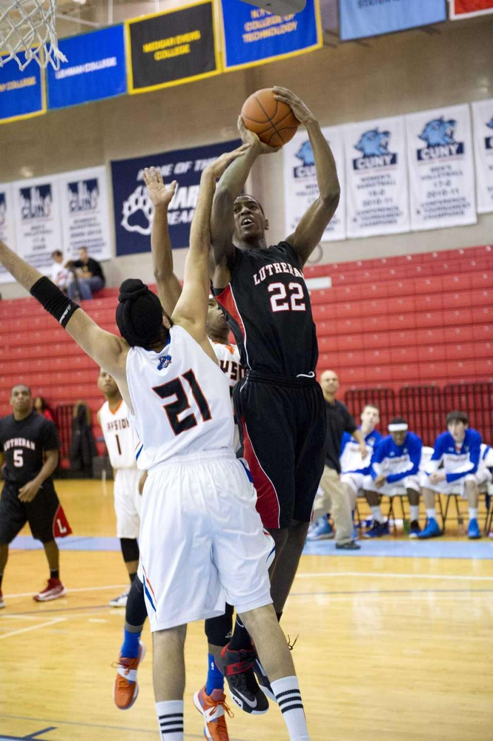 Kentan Facey of Long Island Lutheran shoots over