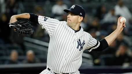 Yankees starting pitcher James Paxton throws against the