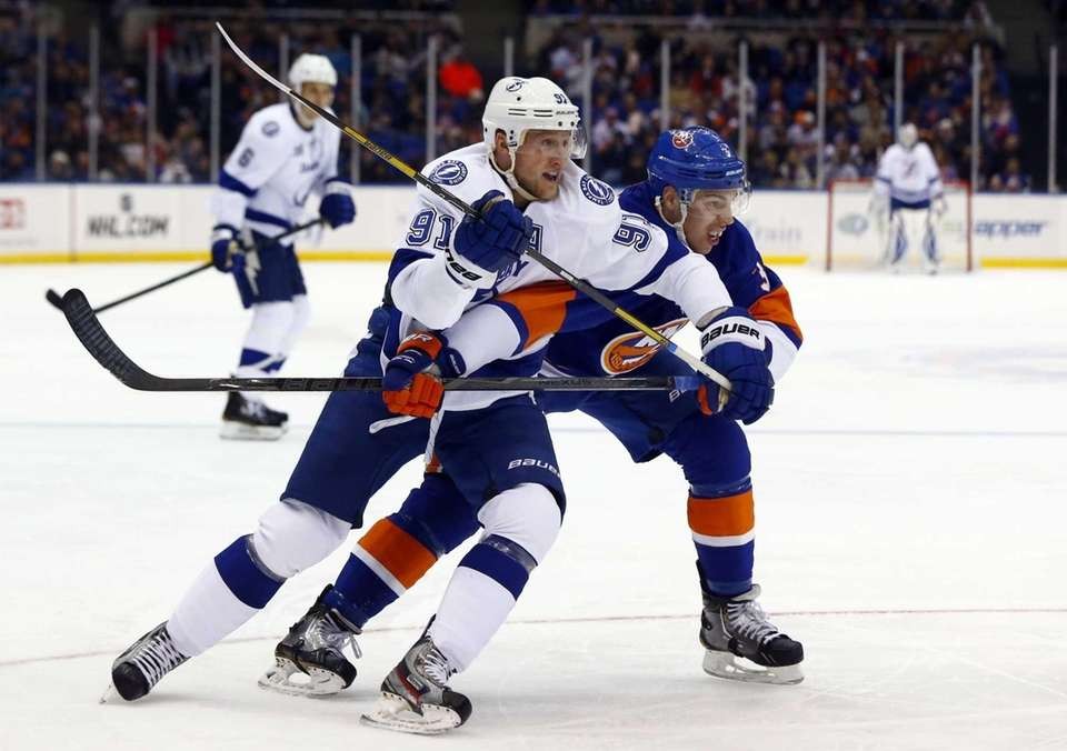 Travis Hamonic of the New York Islanders defends