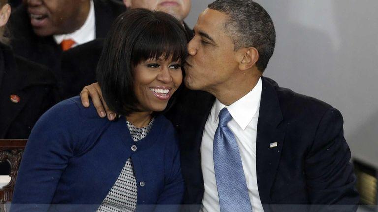 President Barack Obama kisses first lady Michelle Obama