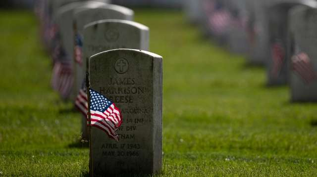 American flags are placed by members of the