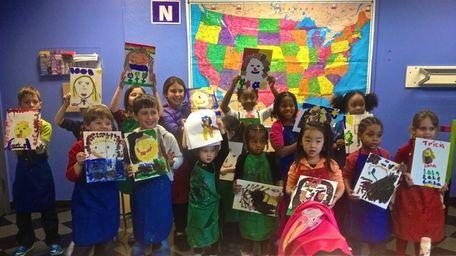 Children present their finished artwork at a workshop