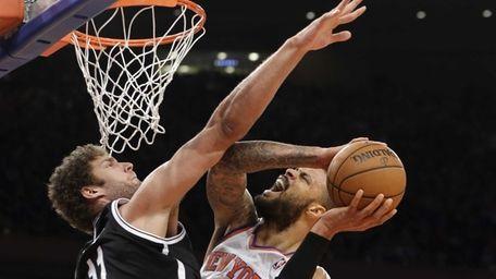 Nets center Brook Lopez (11) fouls Knicks center