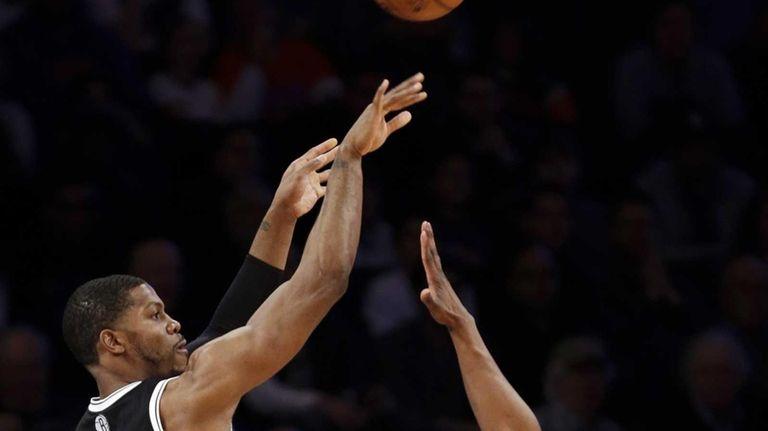 Brooklyn Nets guard Joe Johnson shoots a 3-pointer