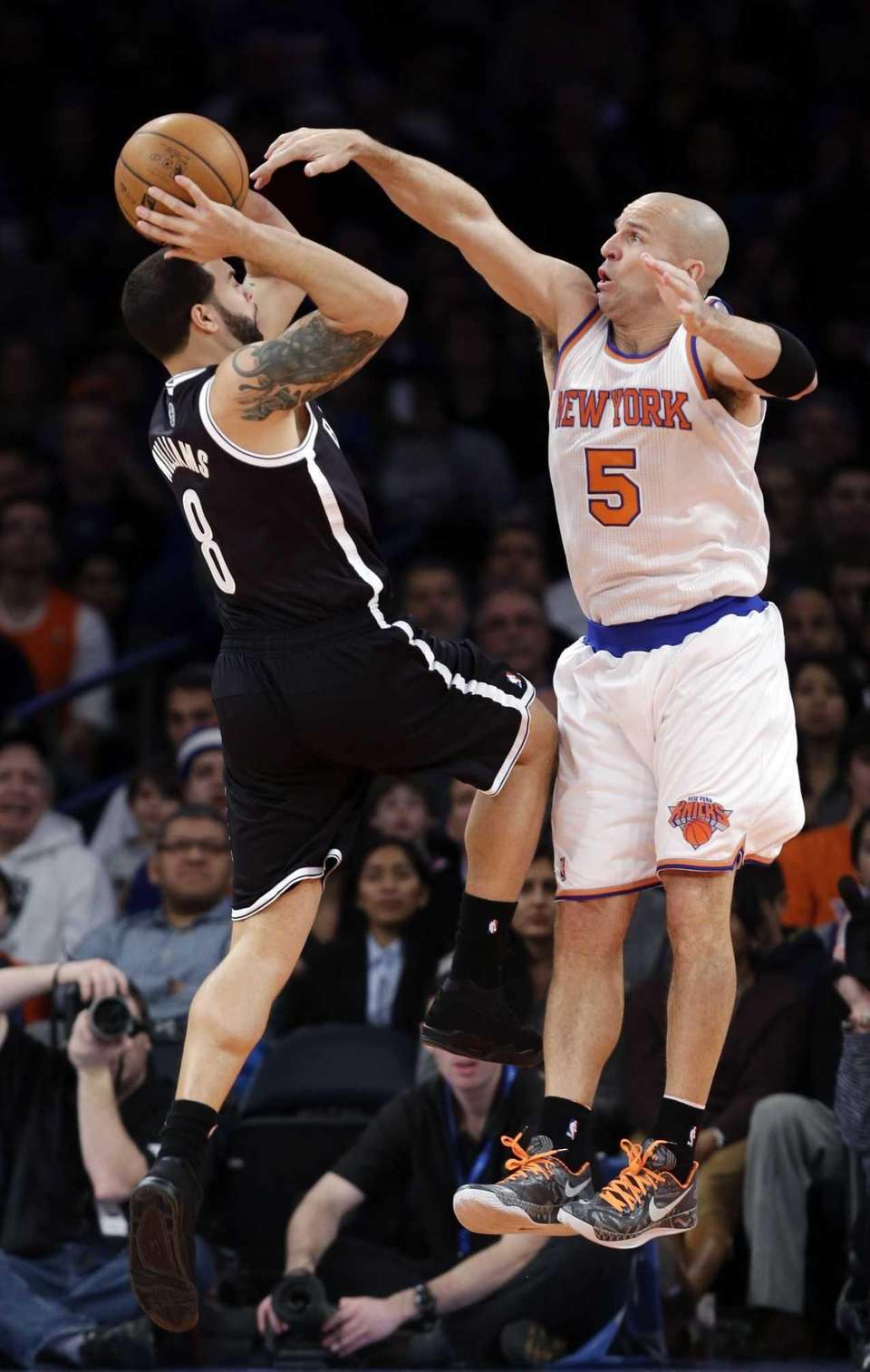 Brooklyn Nets guard Deron Williams tries to shoot