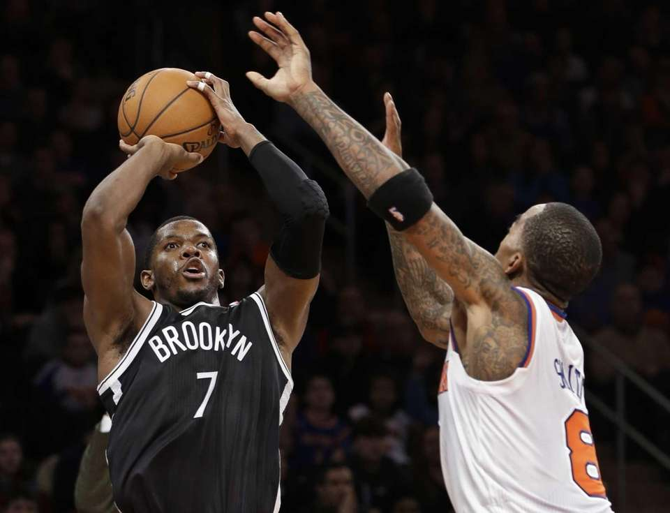 Brooklyn Nets guard Joe Johnson shoots a 3-pointer