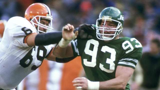 Jets defensive end Marty Lyons (93) rushes on