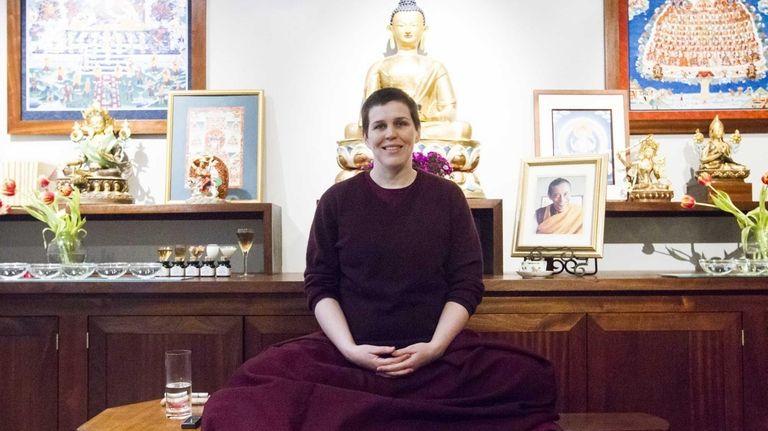 Gen Norden, a Buddhist nun, sits in the