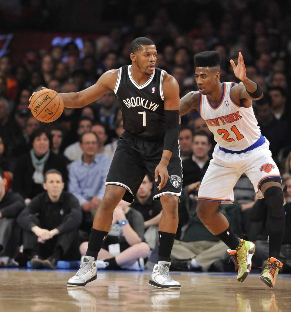 Joe Johnson of the Nets drives on Iman
