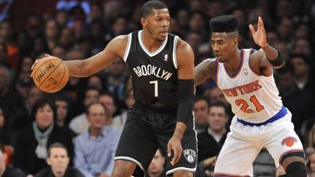 Joe Johnson of the Nets drives on Iman