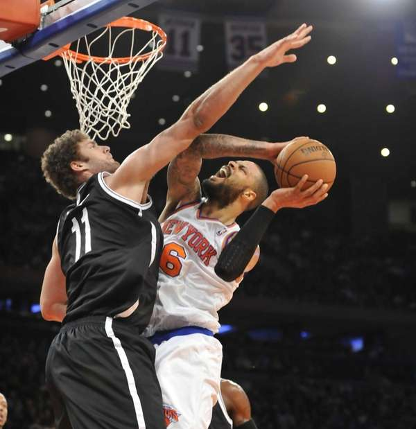Tyson Chandler of the Knicks tries to shoot