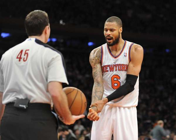 Tyson Chandler of the Knicks tries to convince
