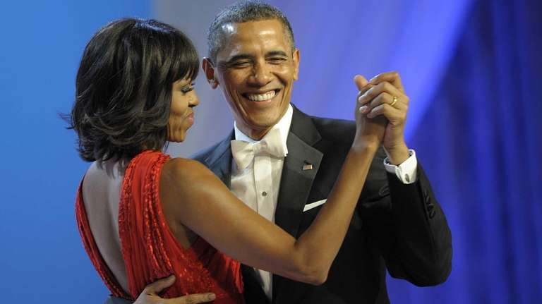 President Barack Obama dances with first lady Michelle