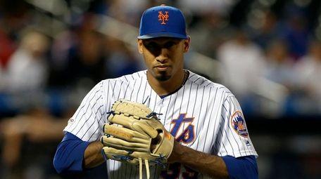 Edwin Diaz #39 of the Mets walks to