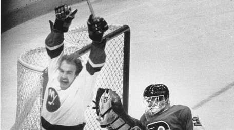 Bobby Nystrom of the Islanders celebrates after he