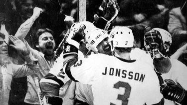 Islanders' John Tonelli has a happy smile as