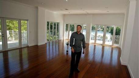 Real estate agent Rick Milea waits for potential