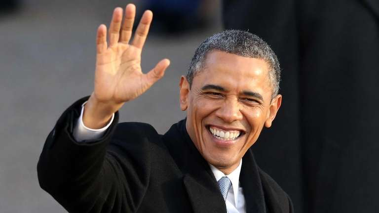 U.S. President Barack Obama waves as the presidential