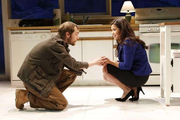 Tobias Segal and America Ferrera in a scene