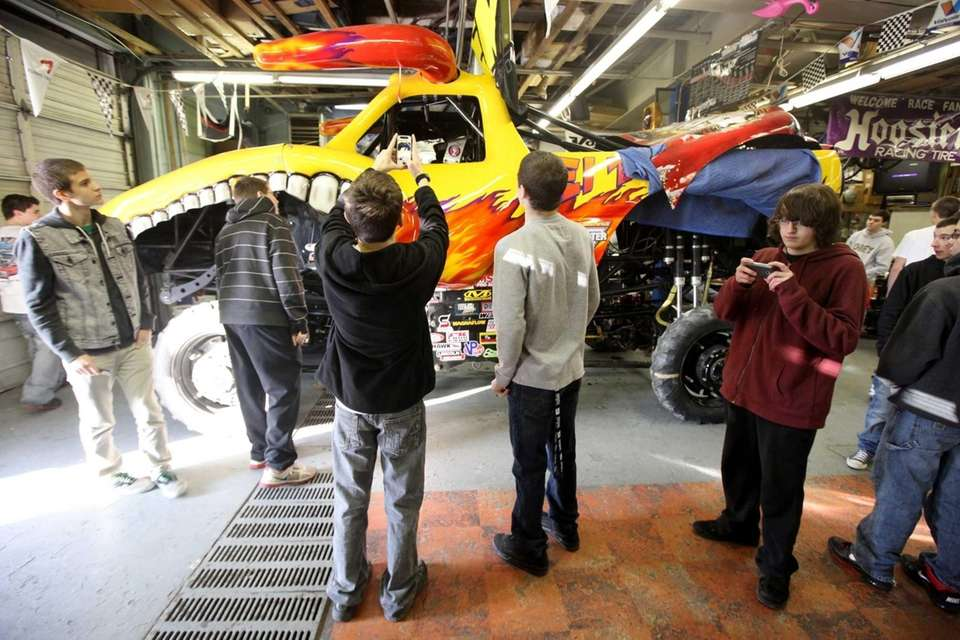 Farmingdale High School automotive technology students get an