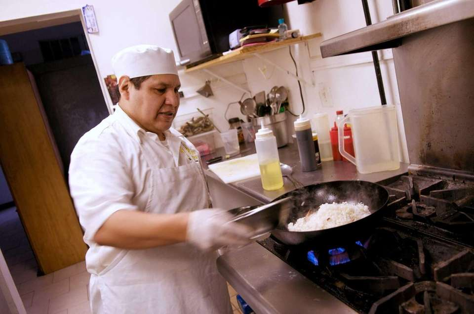 At Golden Chicken, chef Angel Huaylinos cooks the