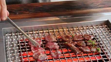 Grill your own meats at Takashi.