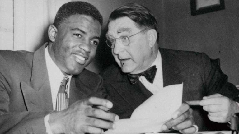Jackie Robinson with Brooklyn Dodgers president Branch Rickey