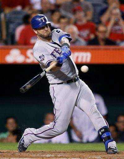 Then-Texas Rangers catcher Mike Napoli hits a home