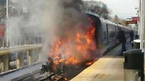 A fire erupts after an LIRR train struck