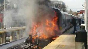 A fire erupts after an LIRR train struck