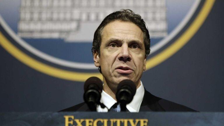 New York Gov. Andrew M. Cuomo presents his