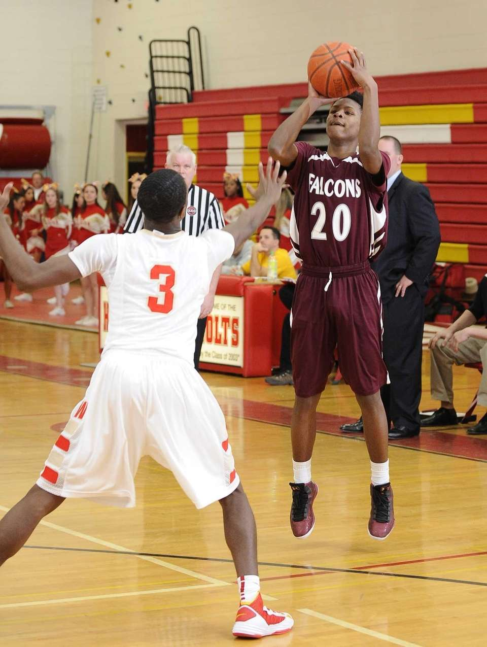 Deer Park's Angelo Riley shoots a three-pointer against