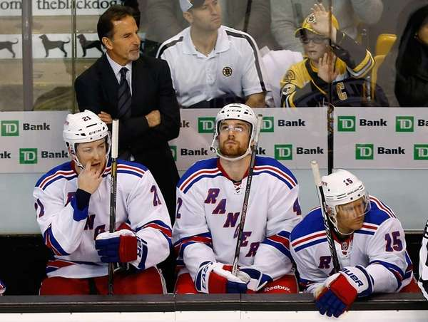 John Tortorella coaches his team during the season
