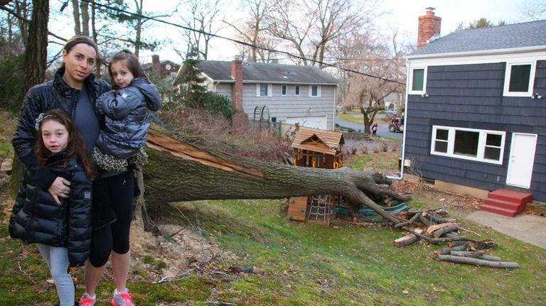 Meri Miller stands with her daughters Maya, 6,