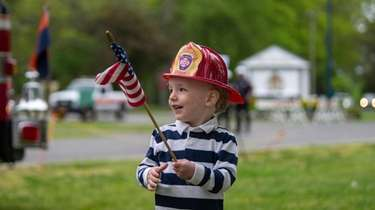 Ryan Chiara, 2, of Garden City, waves his