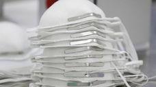 Respirator masks at a factory. Hundreds of thousands