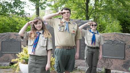 Scouts Scarlett Conn, left, of Troop 163, Evan