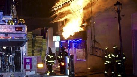 The Huntington Manor Fire Department battles the blaze