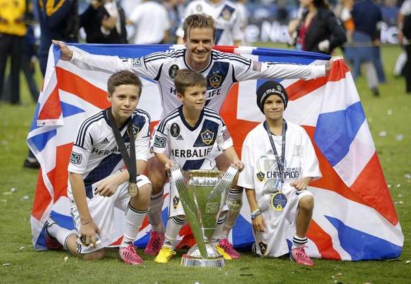 Los Angeles Galaxy's David Beckham, top center, of