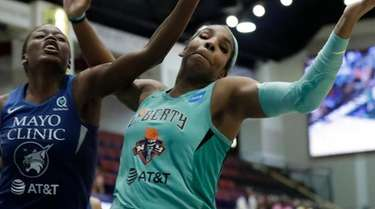 Liberty forward Reshanda Gray, right, turns the ball